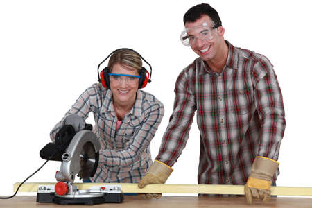 Couple sawing wood photo