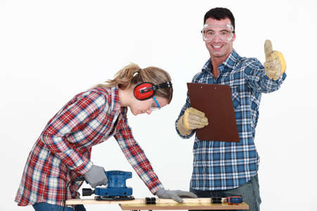 Couple working at a workbench photo