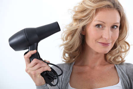 tousled: Woman with a hairdryer