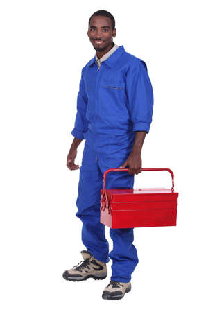 Manual worker with a red toolbox photo