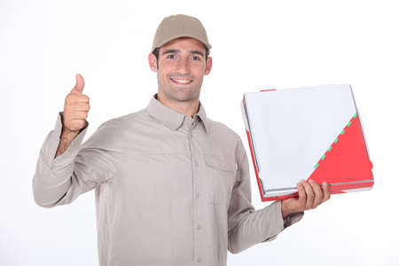 a delivery man holding a packet and doing thumbs up photo