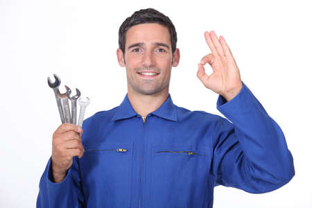 fitter: Mechanic making OK gesture Stock Photo