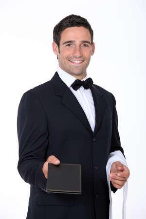 camarero: Camarero con un men� Foto de archivo