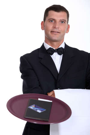 bill payment: Waiter with the bill and a credit card