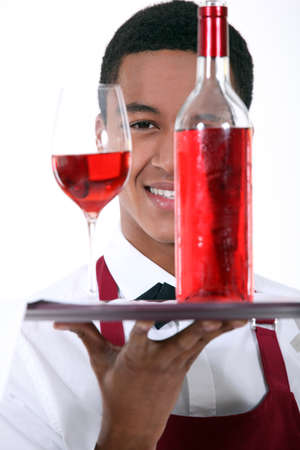 chilled out: Waiter with a bottle and glass of rose wine Stock Photo