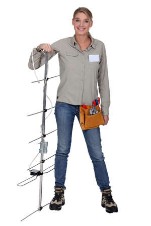 craftswoman: craftswoman installing a television antenna