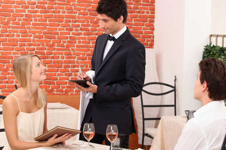 recommendation: a dressy couple ordering in a chic restaurant