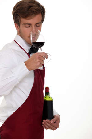 hospitality industry: sommelier tasting the wine
