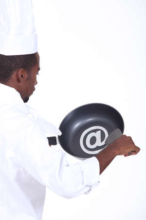 gastronomic: black chef with frying pan