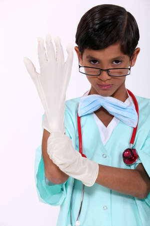grinning: Boy dressed as a hospital surgeon