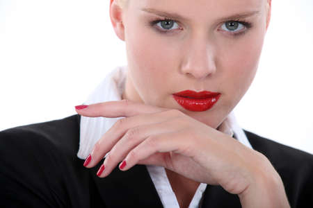 Seductive blond wearing red lip-stick and nail varnish photo