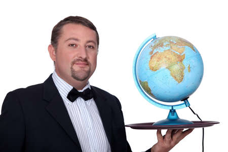 meagre: Waiter holding a globe on his tray Stock Photo