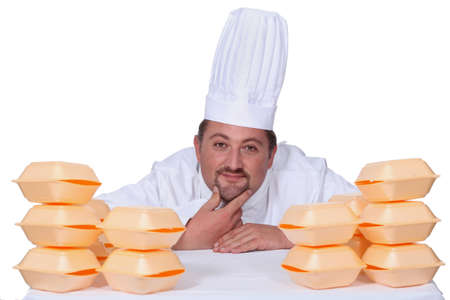 closed box: Chef stood in front of fast food packaging Stock Photo