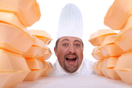 chief cook yelling behind piles of egg boxes Stock Photo - 15674151