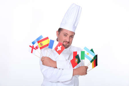 internationally: Chef holding flags Stock Photo