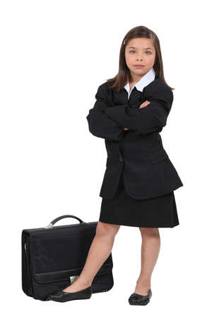 10 15 years: Girl dressed in black with a briefcase Stock Photo