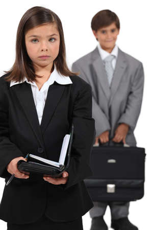 Little boy and girl dressed in business clothing Stock Photo