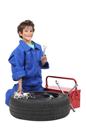 rolled up sleeves: boy with wheel