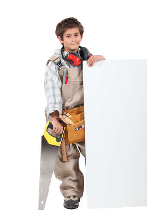 Boy builder with a board left blank for your message photo