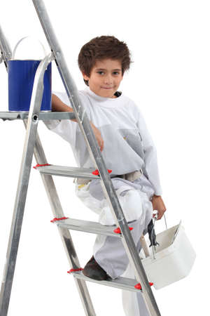 5 6 years: Young boy painting