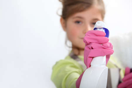 span: Young girl cleaning