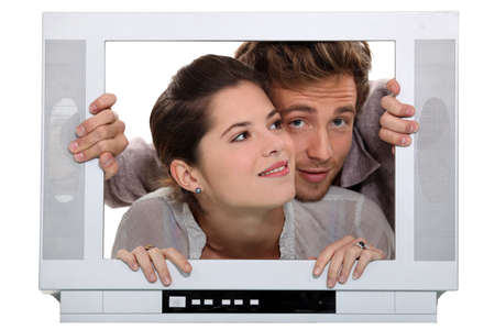25 30 years women: Couple inside a television set