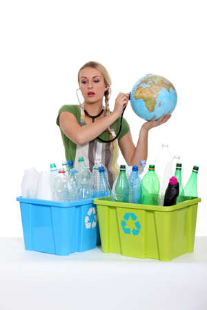 greenhouse effect: portrait of a woman with plastic bottles Stock Photo