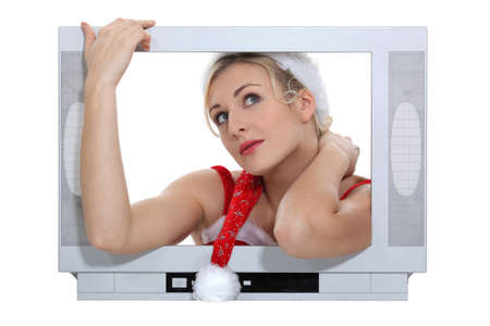 high definition: Woman with Christmas hat behind TV screen Stock Photo