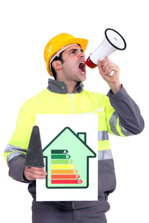Man with energy rating poster shouting into megaphone photo