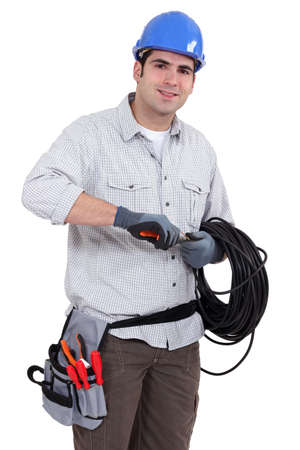 electric wire: Electrician preparing cable