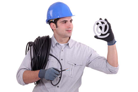 timeless: Electrician with email symbol Stock Photo