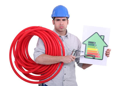 grouch: Grumpy man giving a property an energy efficiency rating of G Stock Photo