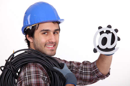 online internet presence: Electrician with an @ sign