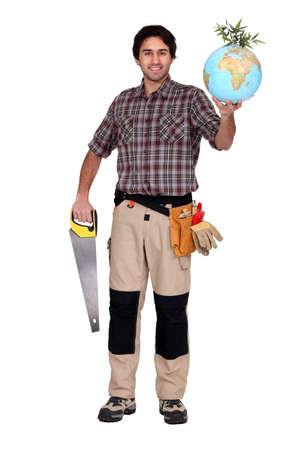 sea saw: Man holding saw and globe