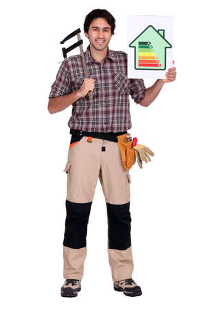 energy efficient: Man holding caliper and energy rating poster Stock Photo