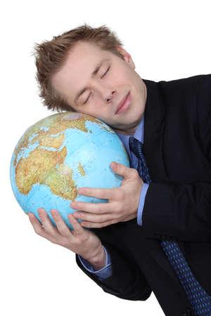 online internet presence: A businessman loving his globe