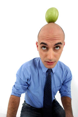 Bald man with apple on the head Stock Photo - 15672621