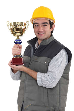 Construction worker with a trophy photo