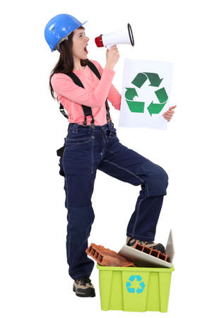 brick earth: Eco-friendly tradeswoman yelling into a megaphone Stock Photo