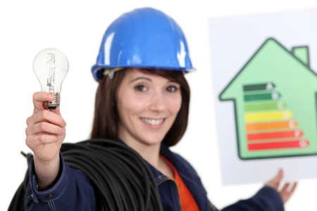 Woman holding energy rating poster and light bulb Stock Photo - 15672436