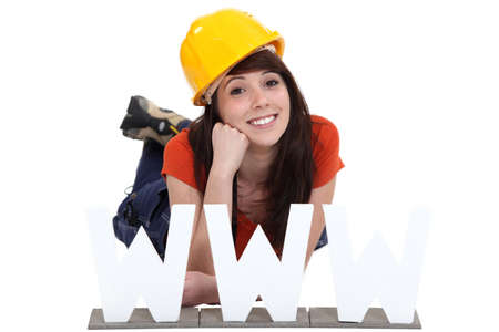 young craftswoman posing behind a WWW symbol Stock Photo - 15717998