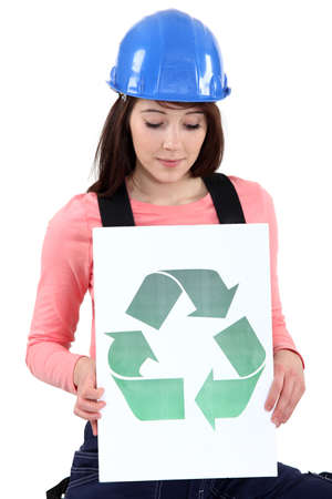 eyelids: Tradeswoman holding a recycling sign