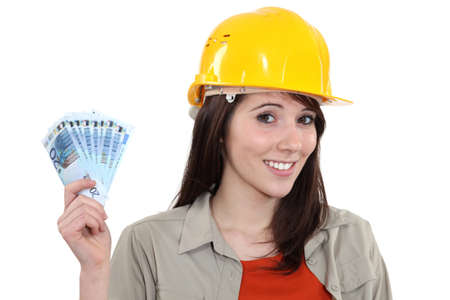 handy: Young handy woman holding wage Stock Photo