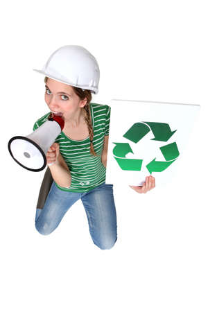 reprocess: Construction worker calling you to recycle Stock Photo