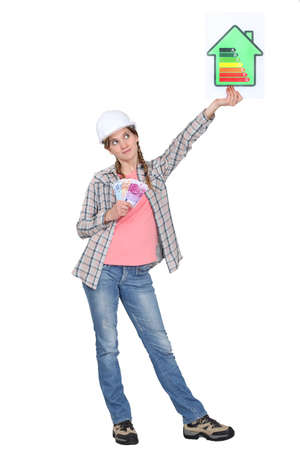 Woman holding energy rating sign photo