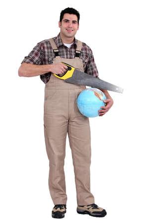 sea saw: Builder sawing globe