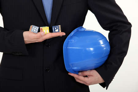 architect in suit holding hard hat Stock Photo - 15718408