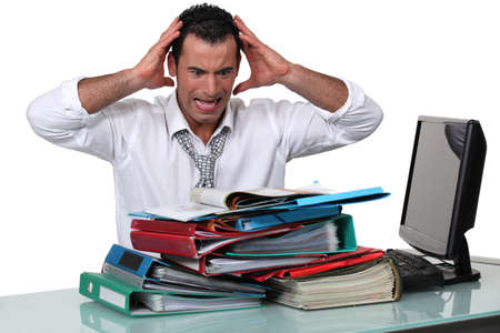 stressed out: Overworked office worker Stock Photo