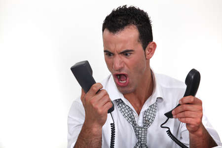 Man shouting at telephone Stock Photo - 15718484