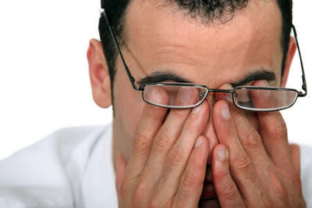 hands covering eyes: Tired man rubbing his eyes Stock Photo